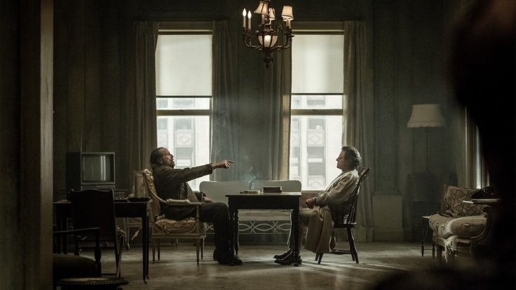 Peter Stormare (left) menacingly challenging Ian McShane (right) to a game of chess.